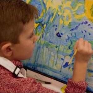 boy painting closeup