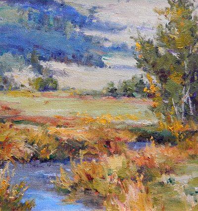 A stream winds through a meadow