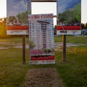Dale Small - Access to Excess sign with the center section of a billboard for condos removed.