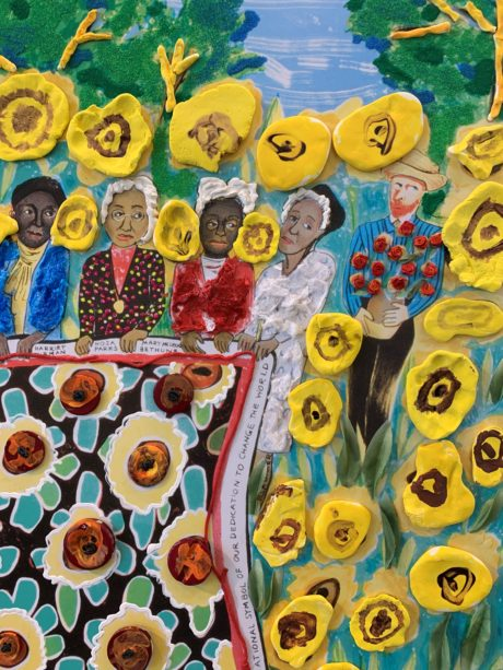 Artwork created by Envision Arts After-School Youth and Teen program, featuring images of people including four women of color and a man holding a basket of roses. Yellow flowers pop up from the canvas.
