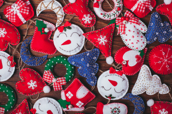 felt Christmas decorations on the wooden table as a background