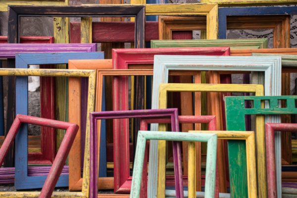 Multi-colored frames are stacked in front of one another.