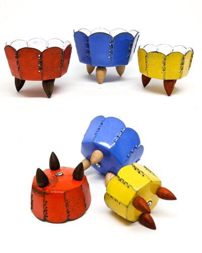 red, blue and yellow three legged metal art