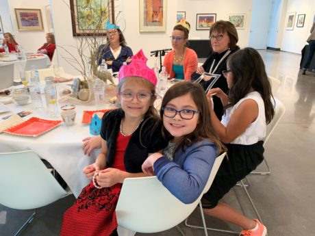 A table of young girls and mothers at the Mother Daughter Tea event