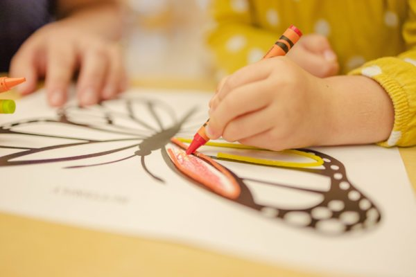 detail image of child drawing butterfly